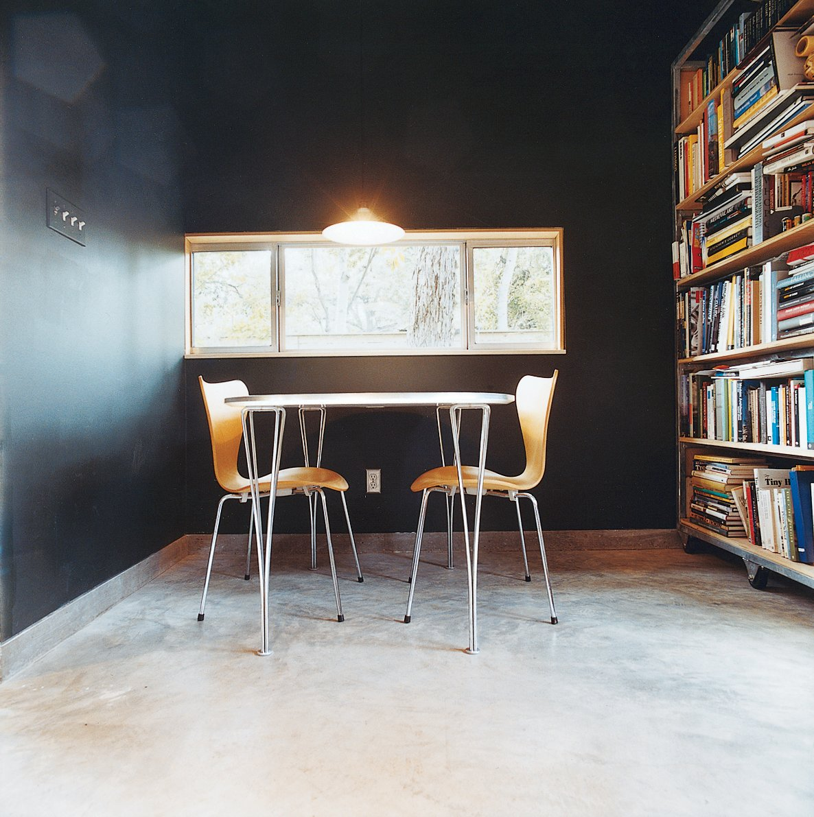 Office, Chair, Concrete Floor, and Bookcase These 3107 chairs and Superellipse table are from Fritz Hansen.  Photo 3 of 5 in Small Amidst Sprawl