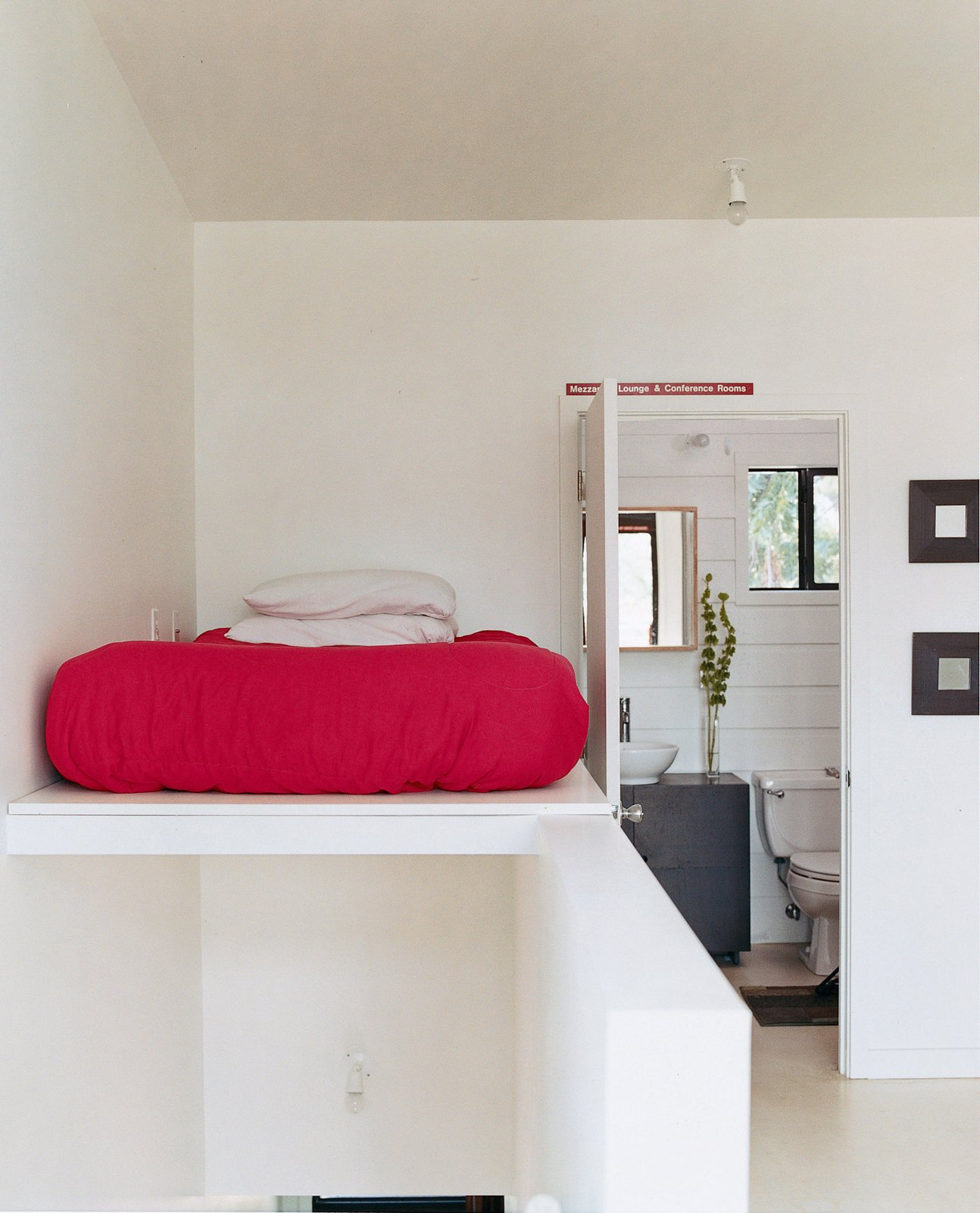 The bed is perched above the staircase leading from the second-story living area to   the third-story sleeping area.  Photo 6 of 11 in New Orleans, LA