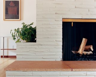 White was charmed by the original fireplace with a built-in planter—so much so that the new open floor plan is centered around it.
