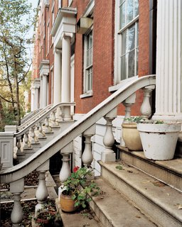 """The façades of the Greek Revival town houses that comprise """"the Row,"""" on Greenwich Village's Washington Square, still evoke pre–Gilded Age New York. Within, however, modernity prevails."""