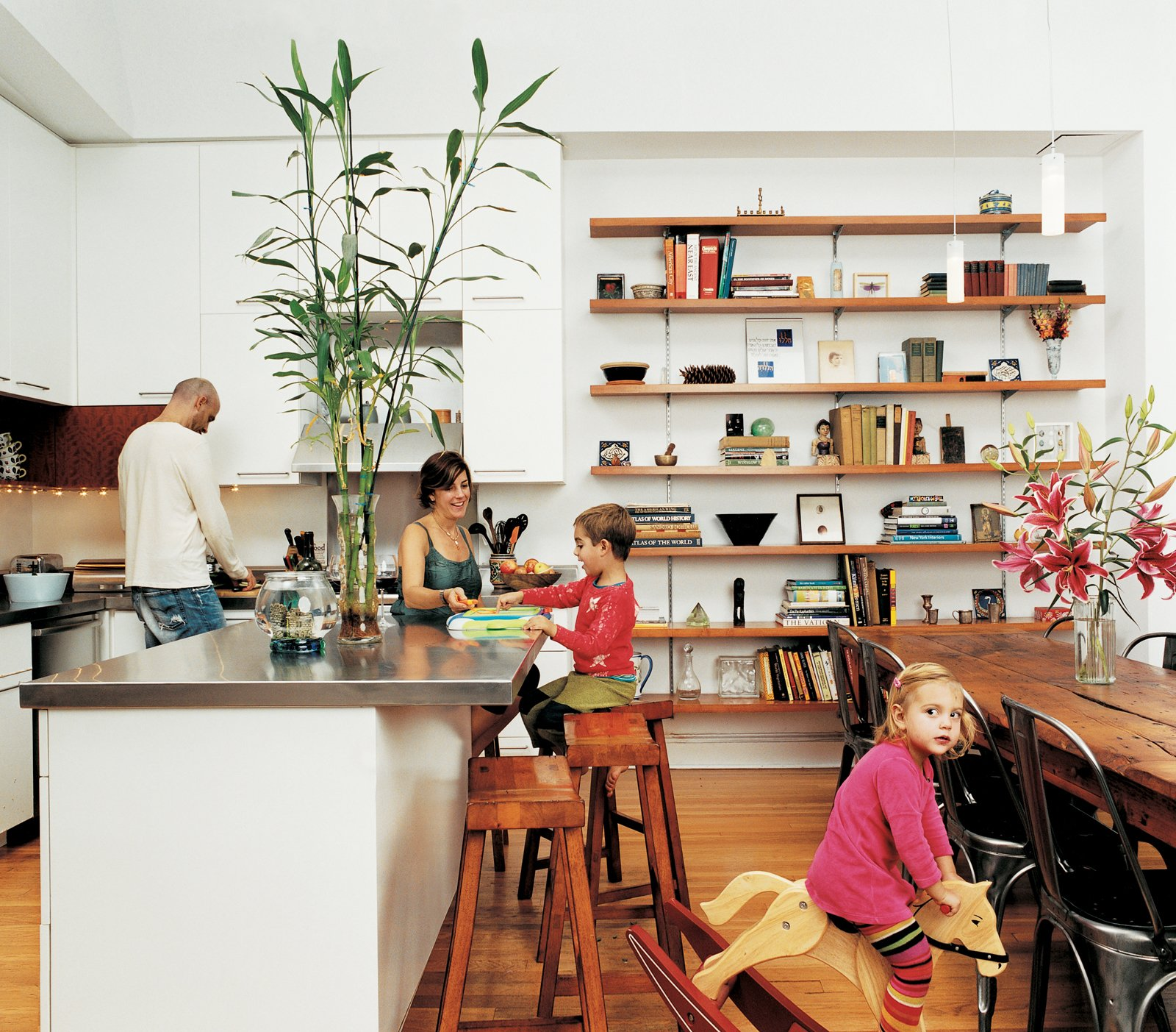 The Ogrodnik/Bardin family enjoy the pleasures of family life in the kitchen.  Photo 1 of 1 in Discuss: What Details Bring a Room to Life? from Row House Revival