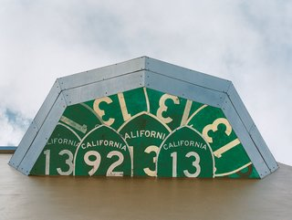 As seen from below, highway signs from California make for a unique exterior detail.