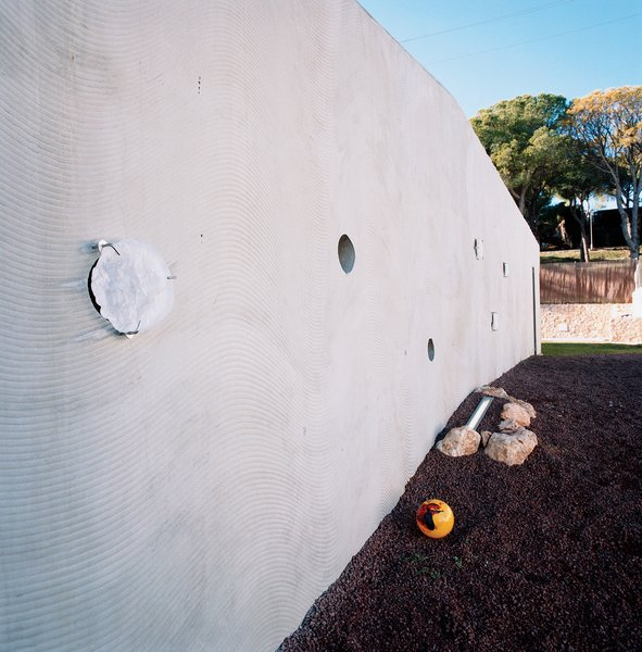 A CNC-cut formwork was used to create the wavy pattern in the home's concrete outer walls.  Photo 8 of 10 in Suburban House of the Future by Cloud9