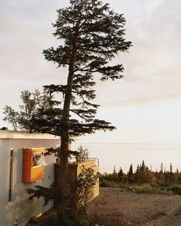 Laid out in a 270-degree panorama in front of the house is the frosty expanse of Cook Inlet, cascading rocky mountains, and a white sun as big as a dinner plate.