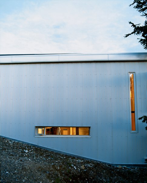 """Sattler-Smith explains that """"the north side of the house is covered with corrugated galvanized steel and pierced with only a few very small windows; this protects from the 100-mile-per-hour north winds."""""""