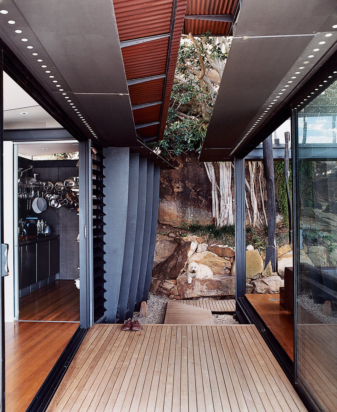 Outdoor The family dog enjoys the shade provided by the corrugated-copper roof overhangs.  Photo 8 of 11 in Three Glass-and-Copper Pavilions Conquer the Cliffs