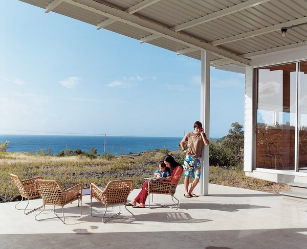 Outdoor, Large Patio, Porch, Deck, and Concrete Patio, Porch, Deck Architect Craig Steely designed this house for himself, his wife Cathy Liu, a painter, and their son, Zane, that looks out to the Pacific Ocean from a lava flow on the big island of Hawaii.  Photo 1 of 11 in Go With the Flow