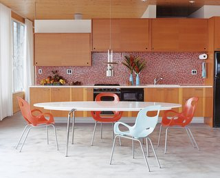 Go With the Flow - Photo 9 of 11 - The concrete floor takes on a silky appearance in the kitchen and dining areas. The Gideå table is from IKEA, the Karim Rashid Oh chairs are from Umbra, and the Erik Magnussen kerosene Ship's lamp is by Stelton.