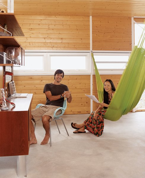 """A vintage suspended wall unit serves as a home office. Cathy demonstrates the """"third bedroom""""—a three-person hammock from Oaxaca.  Photo 11 of 11 in Go With the Flow"""