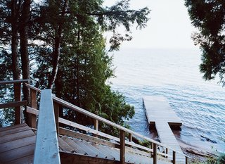 Off the Beaten Path - Photo 5 of 10 - A wooden stair leads from the house down to a dramatic view of Lake Superior.