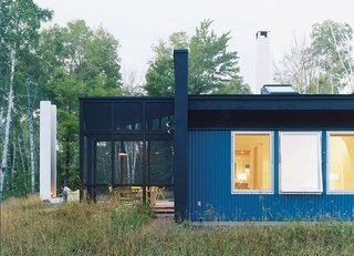 "A side view of the house and of Salmela's signature architectural feature: the ""unchimney."" All windows are from Loewen."