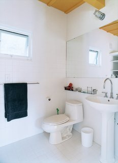Both bathrooms are simple and basic, with Dornbracht fixtures as the only real extravagance.