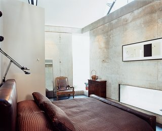 The custom leather platform bed was designed by Shikany's firm, PS Studios.