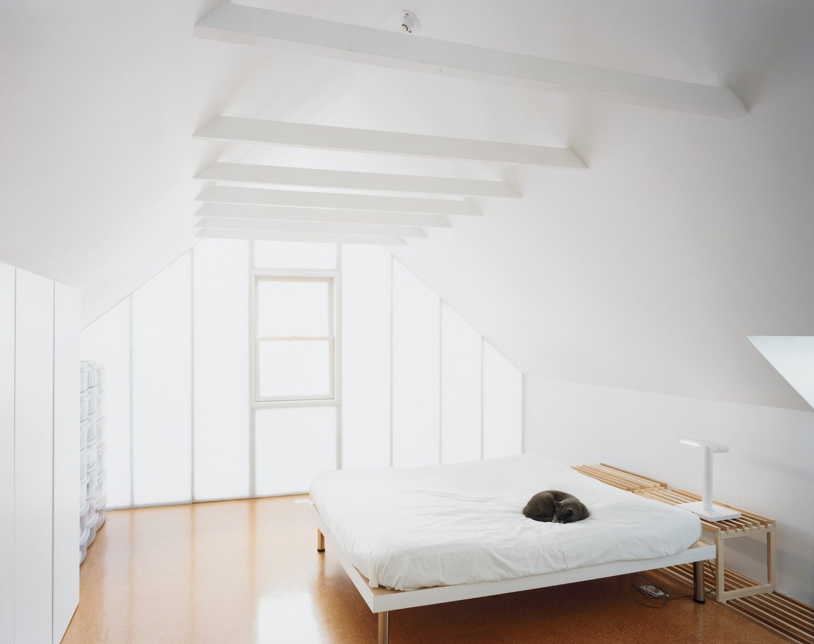 Uni exposed the ceiling beams, formerly concealed by drywall and a kitschy light fixture upon which Schenk would hit his head. They built a platform bed using a couple of hollow doors as a surface for the mattress.  Photo 11 of 11 in New Beginnings