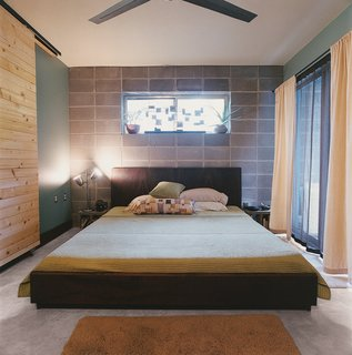 The platform bed in the master bedroom was crafted by a local woodworker.