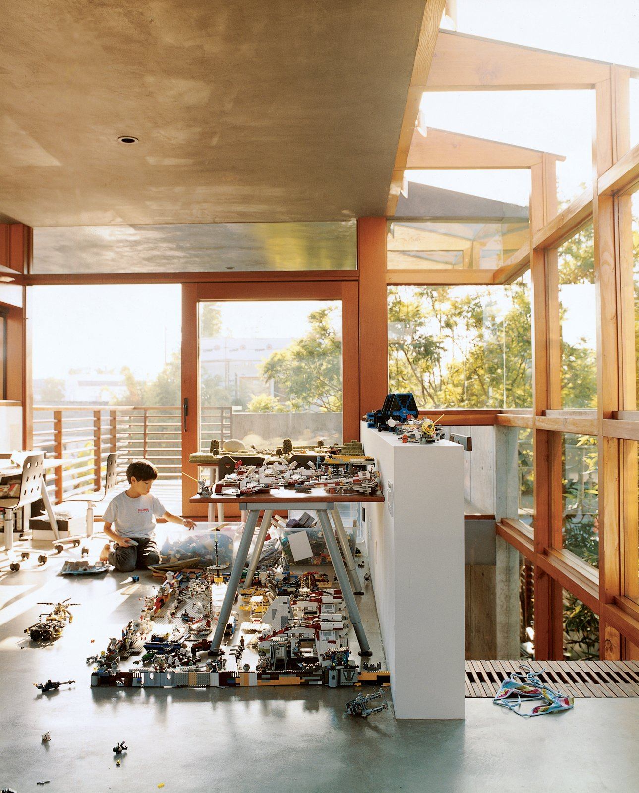 In the new addition to the Hertz/Fong residence, the architect's son Max tinkers with his extensive array of Legos and War Hammer miniatures in the upstairs office/playroom.  Photo 1 of 6 in Sustainability in Stages