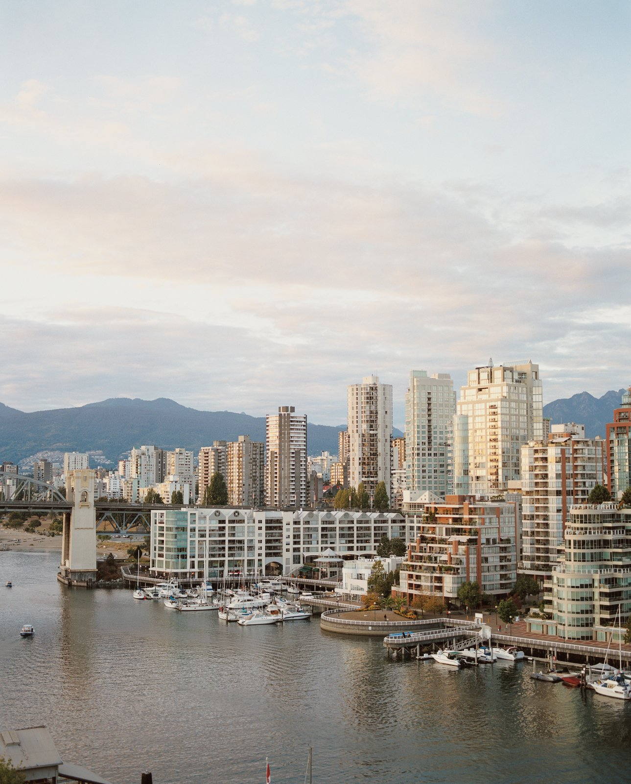 With the Coast Mountains in the background and the Strait of Georgia in the foreground, there's no bad view if you live in one of Vancouver's many midrises.  Photo 2 of 8 in Vancouver is an extroverted city