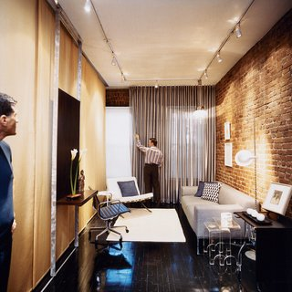 Milan Hughston's quiet street in Manhattan's West Village is moments from the neighborhood's boutique shopping and nocturnal ruckuses. Architect Joel Sanders made Hughston's space multi-functional; here it's shown as a living room, for relaxing or entertaining friends.