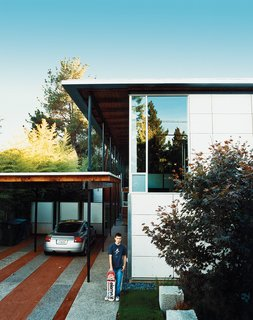 The New Suburbanism - Photo 4 of 10 - Turning its back to the street and next-door apartment like a curled-up cat, the long, narrow house spills out sideways to the garden, designed by landscape architect Andrea Cochran.