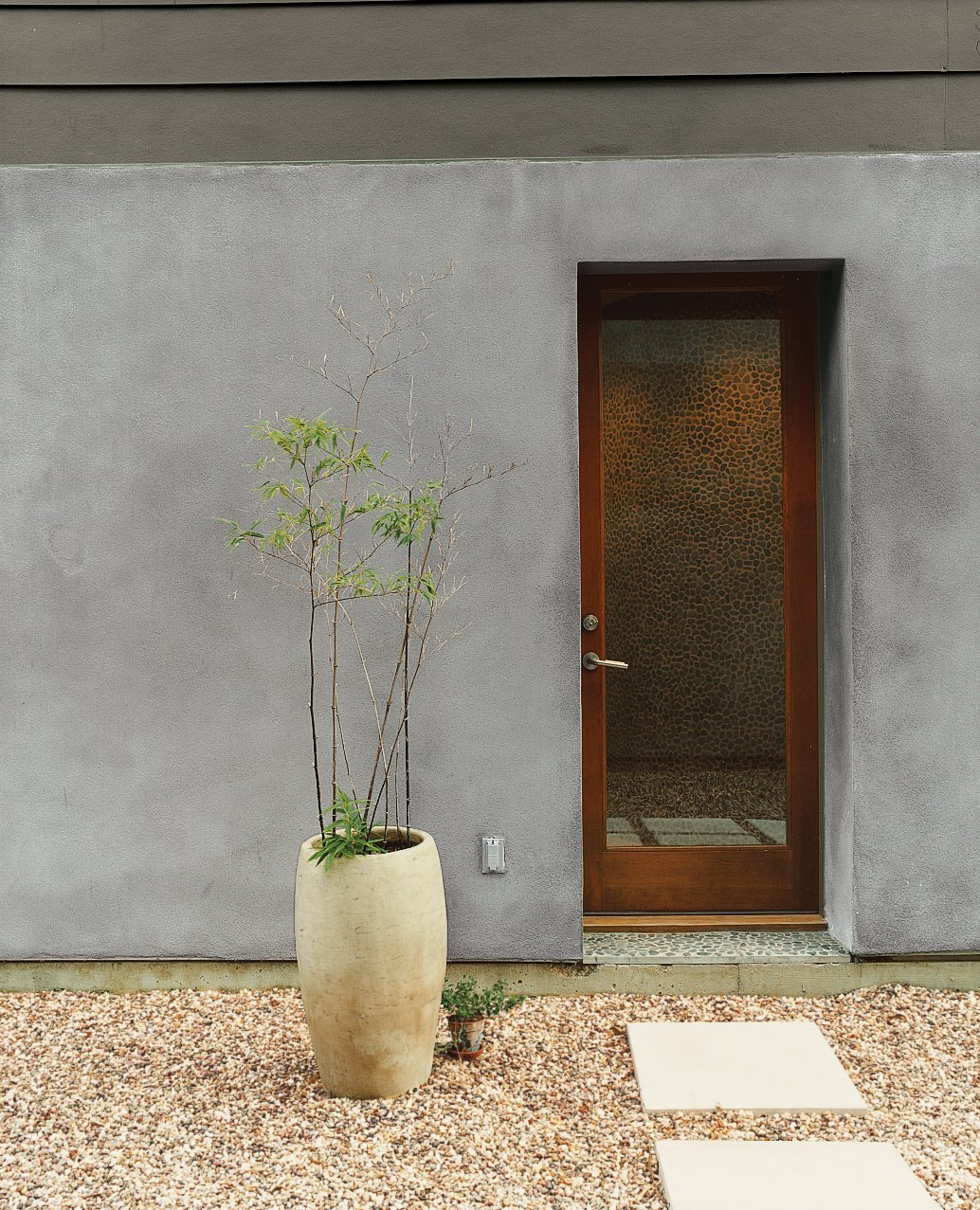 Designers Matt and Tina Ford created the concrete planters that dot the gravel courtyard.  Photo 2 of 8 in Houston, We've Solved a Problem