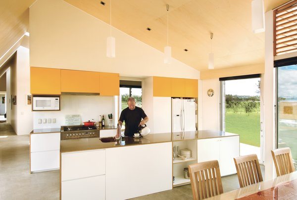 Ted Preston takes charge of hot beverages in the kitchen. The architects diligently avoided cold, hard minimalism with a honey-tinged Italian poplar ceiling.  Photo 3 of 5 in Long Division