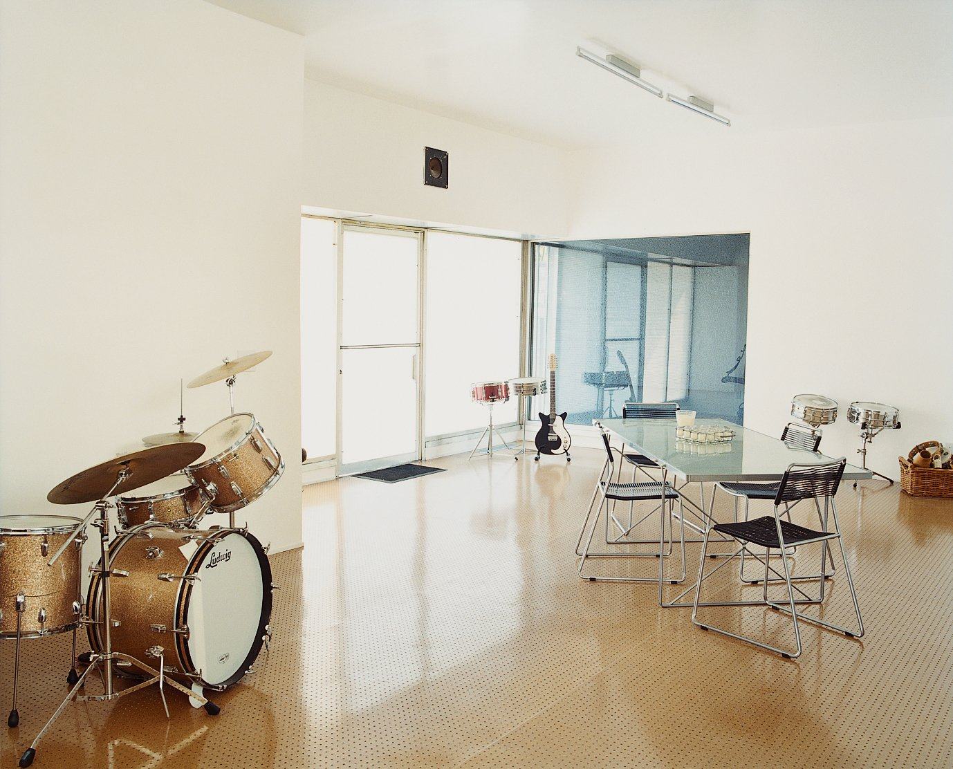 Brill softens his spartan living space with his music. An IKEA set of table and chairs commingles with some 1963 Slingerland drums.  Photo 4 of 8 in Drumming Up Design