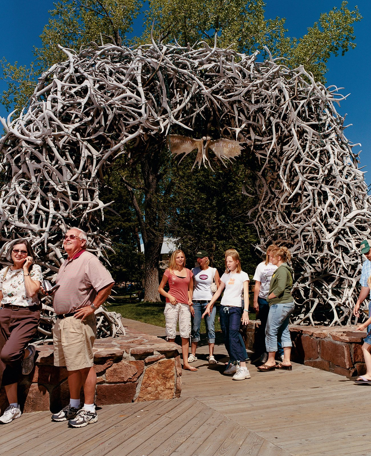 Locals crowd around Jackson's iconic town common.  Photo 7 of 10 in Jackson, WY