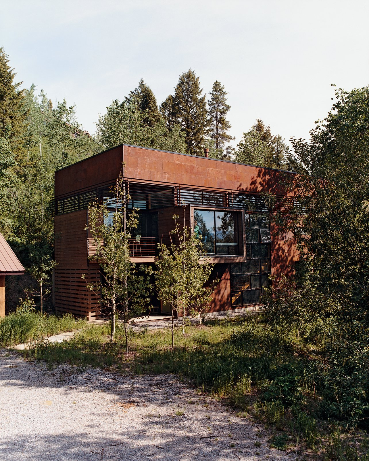 Exterior, House Building Type, Cabin Building Type, and Flat RoofLine The simple frame of the Stanwood residence is clad with oxidized steel finished with linseed oil and outfitted with Sierra Pacific windows and doors.  Photo 8 of 10 in Jackson, WY