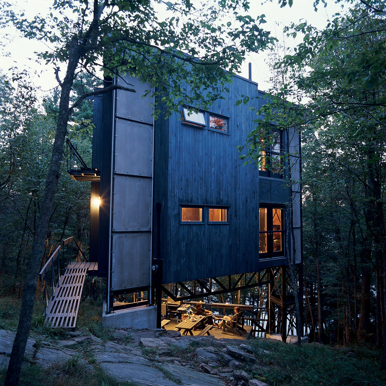 Exterior, House Building Type, Wood Siding Material, Metal Siding Material, and Flat RoofLine Scrap steel and reclaimed wood clad the three-story triangular tower, which hovers over a small deck and outdoor space.  Photo 1 of 5 in Canadian Beacon