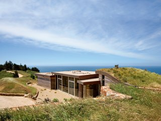 Architect Mary Ann Schicketanz created a 1,900-square-foot home in Big Sur, California, that hugs its hillside site.
