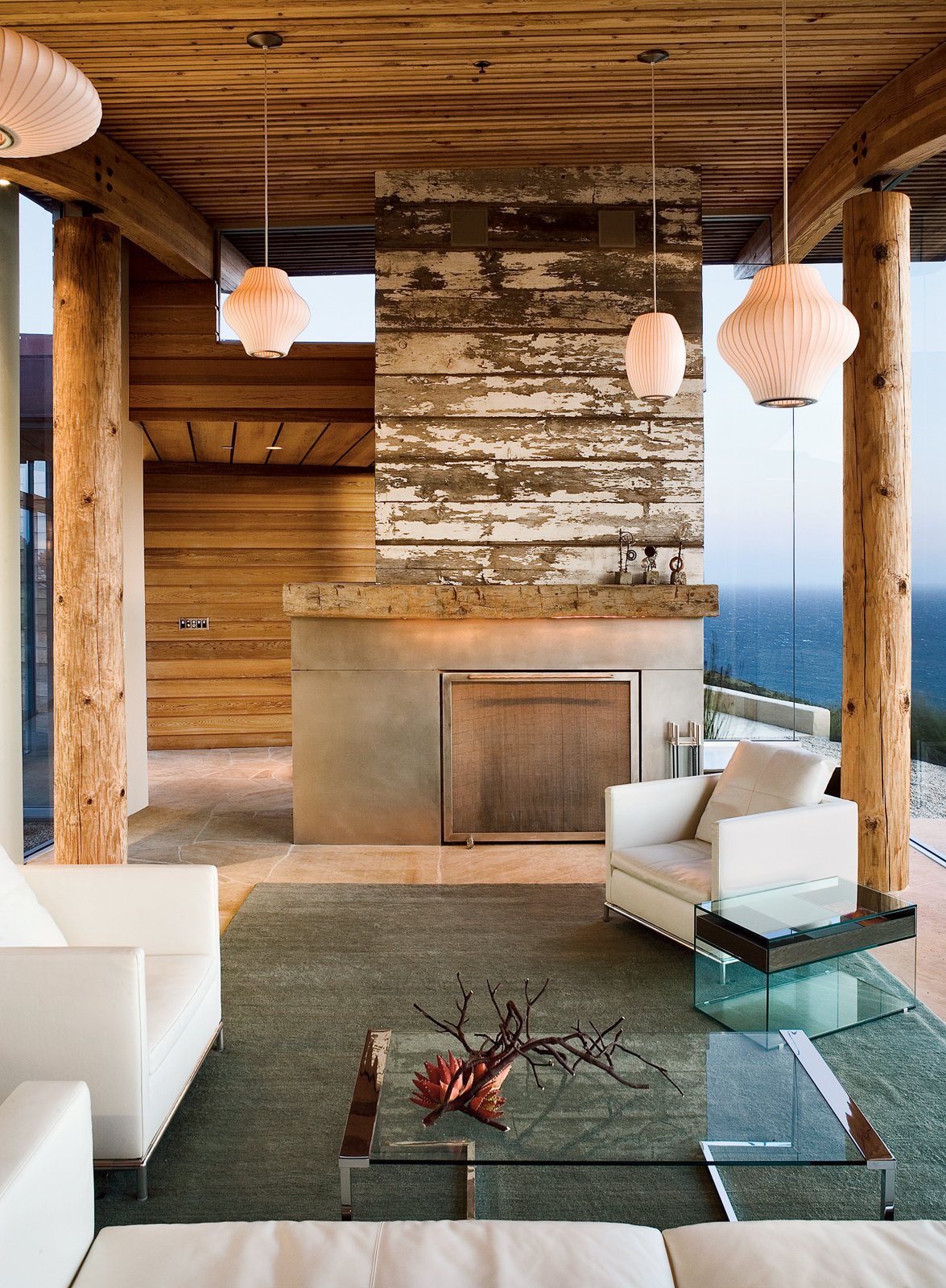 A reclaimed-wood fireplace is a defining feature in the living room.  Photo 2 of 6 in Big Sur: Going Coastal