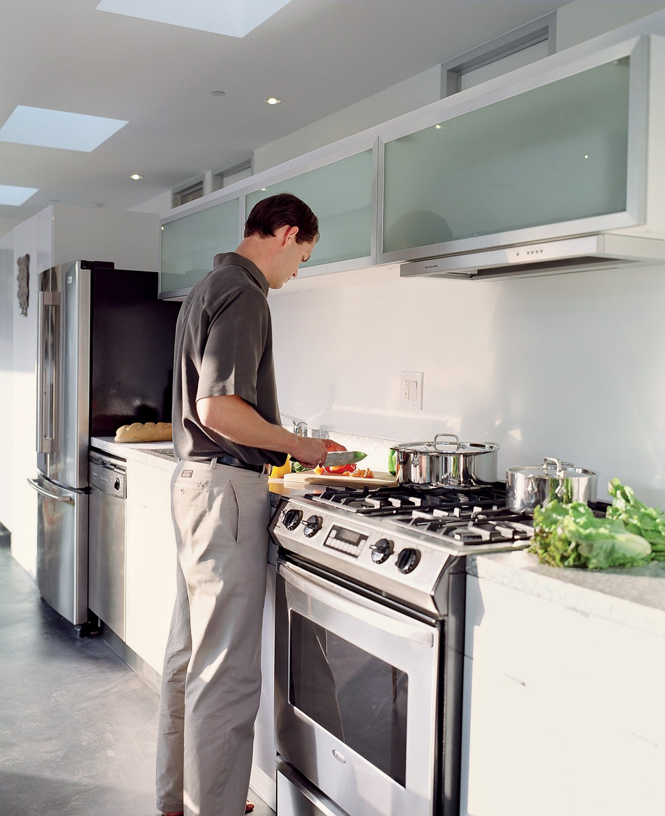 Reitz in the kitchen, which is outfitted with efficient fluorescent lighting and Energy Star appliances.  Photo 3 of 4 in Taking His Own Advice