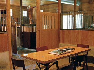 A Stable Office Environment - Photo 1 of 4 - The largest stall (below), formerly used for washing thousand-pound animals, was the perfect size for a meeting room.