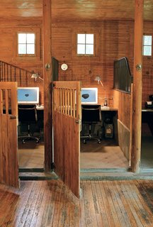 A Stable Office Environment - Photo 2 of 4 - The stalls provide the same demarcated, cozy space for concentration as a cubicle, but the effect is warm and rich rather than garish and chintzy.