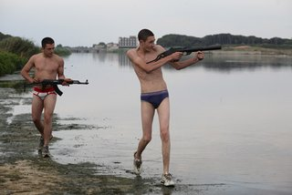 Marco and Ciro testing out stolen guns at a swampy beach in Gomorrah