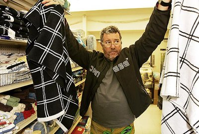 Hollywood, CA - December 04, 2008:  Designer Philippe Starck shops with his wife Jasmine Starck and daughter Ara at a Big Lots store in Hollywood. Philippe Starck is a designer of iconic furniture, products and interiors.  (Al Seib  / Los Angeles Times)  Photo 1 of 1 in Philippe Starck, Discount Shopper?