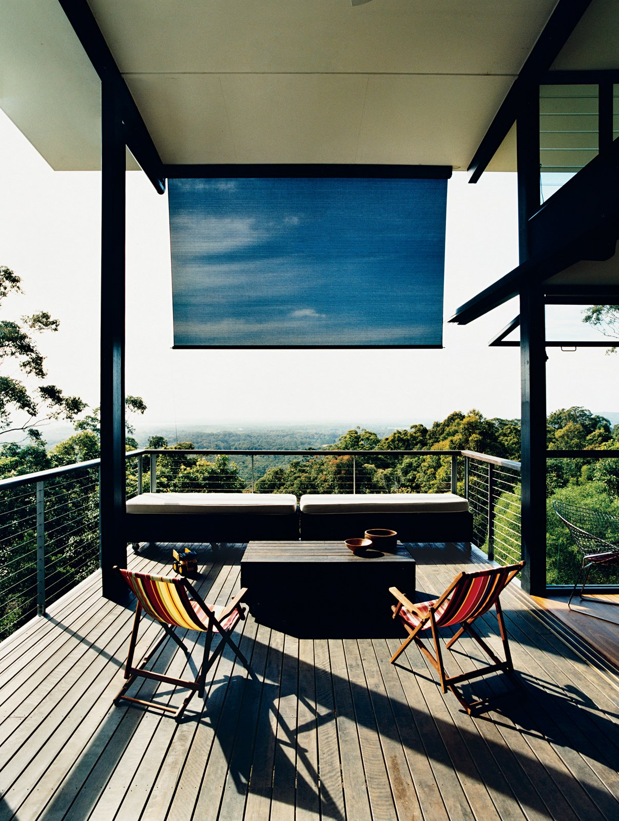 Outdoor, Small Patio, Porch, Deck, and Wood Patio, Porch, Deck A large deck off the living room overlooks the hills of Noosa and the Pacific Ocean.  Photo 2 of 12 in Hillside Family Home in Australia