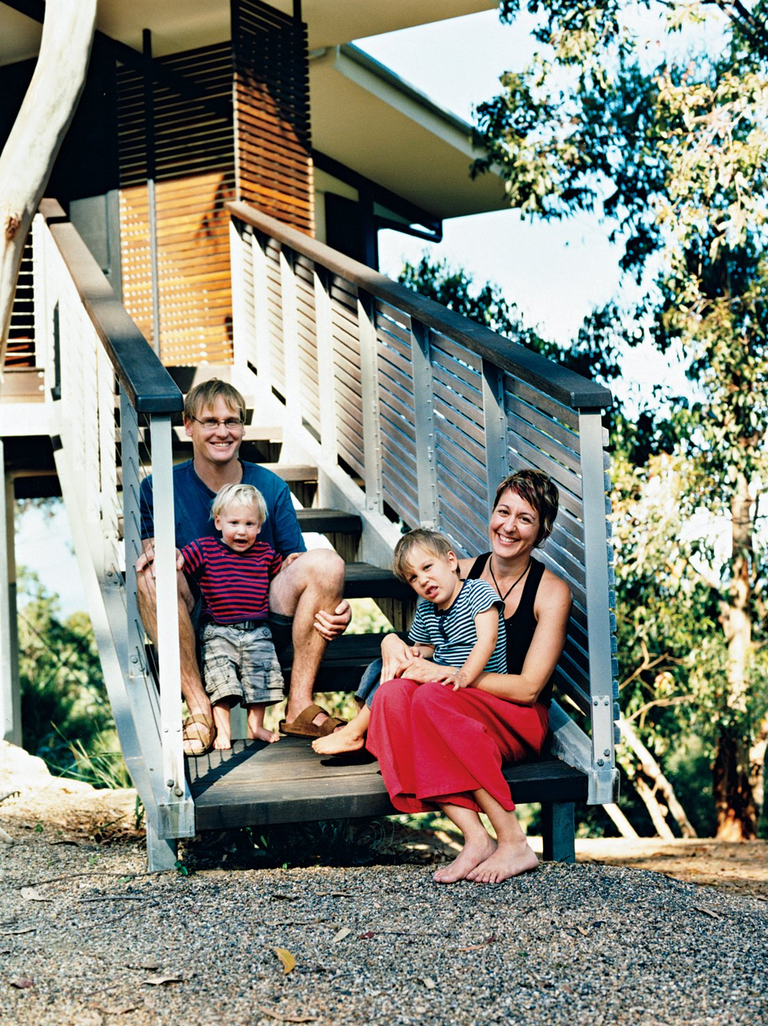 Staircase Stefan Dunlop and Adrienne Webb repose on their front entrance stairs with their sons Keanu and Kobe.  Photo 3 of 12 in Hillside Family Home in Australia