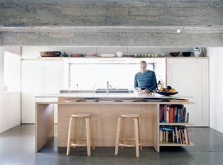 A pair of Aalto stools—in this case, the High Stool 64—are a prominent feature of this kitchen in Balmain Point, Australia, a suburb of Sydney.