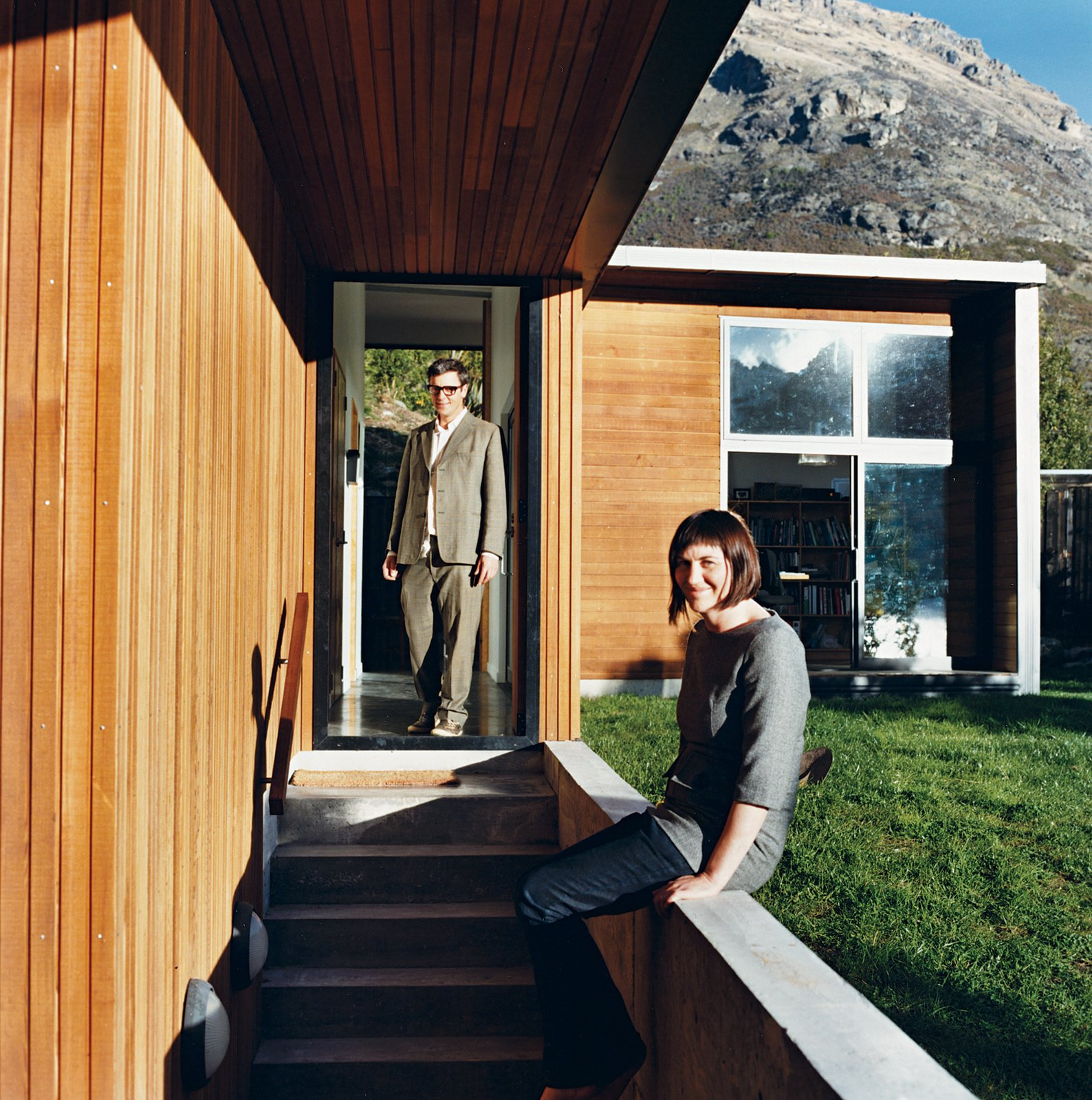 When Bronwen Kerr and Pete Ritchie decided to relocate from New Zealand's capital, Wellington, to Queenstown, on the country's South Island, they designed a new home for themselves and their three children on a site Ritchie had purchased when he was living in the area—a stunning lakeside plot. Working in partnership, the couple devised a home and studio that is separated by a passage through the middle of the building.  Photo 2 of 12 in Nature Nurtured
