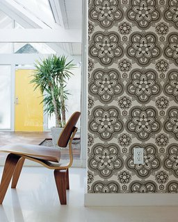 7 Wallpaper Designs That Will Instantly Revamp Your Space - Photo 6 of 14 - The wallpaper from Finland breaks up the clean white surface.