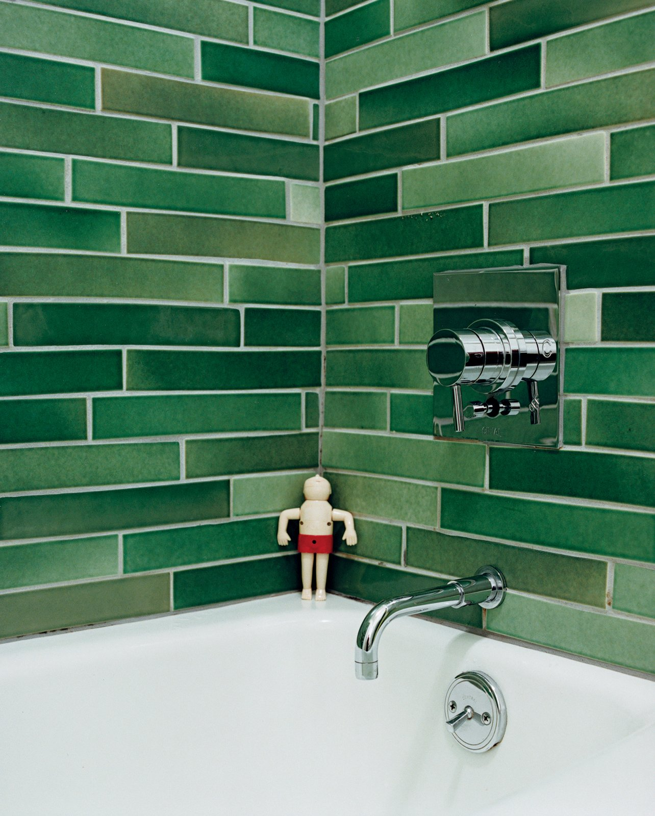 The Heath tiles in the bathroom were hand-selected from boxes of factory seconds. Tagged: Bath Room and Ceramic Tile Wall.  Photo 15 of 15 in A Mid-Century Modern Home in Southwest Portland