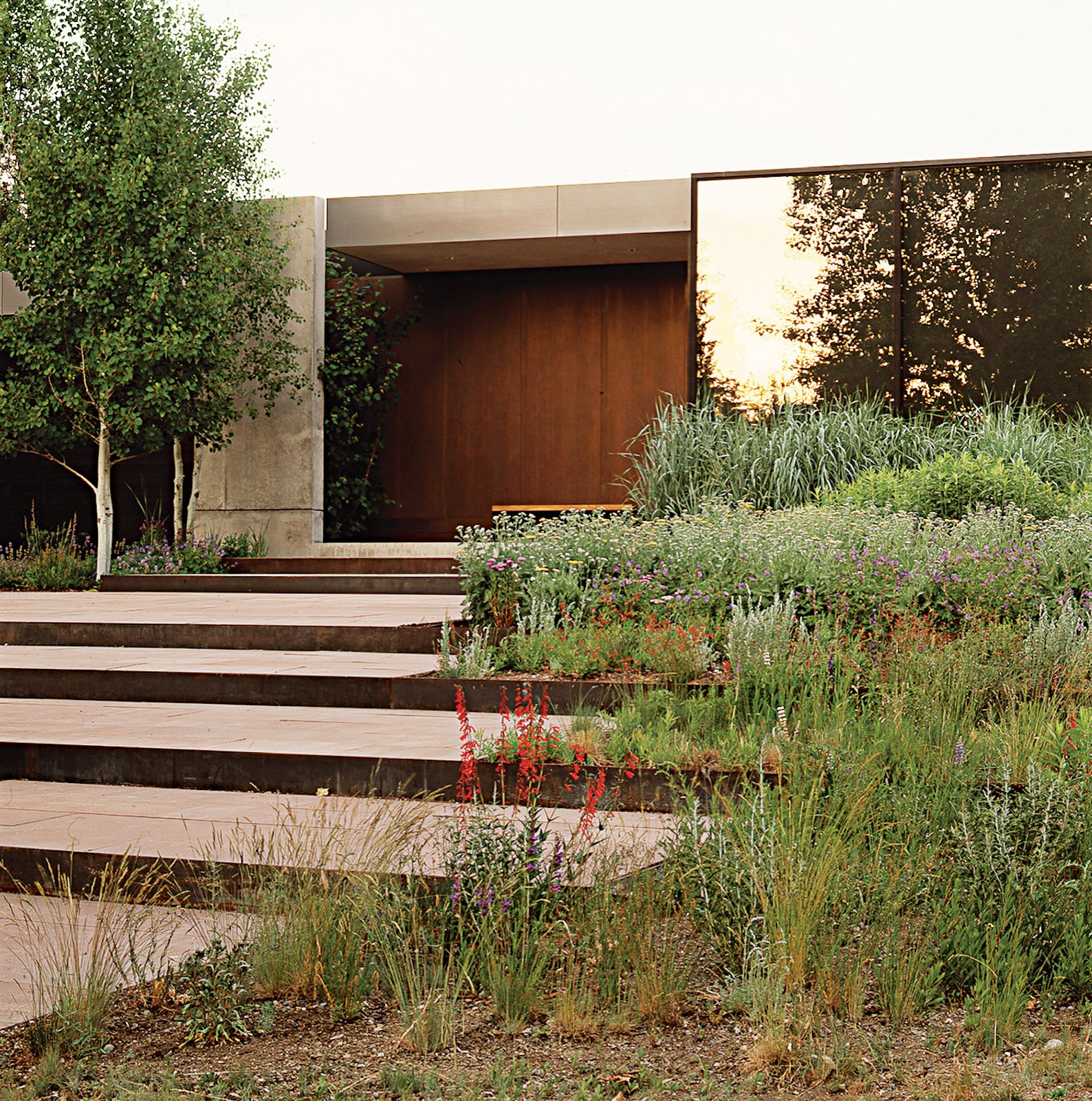 Lutsko Associates chose to integrate stepped terraces into the landscape design of this Ketchum, Idaho home.  Photo 1 of 2 in Well Pruned