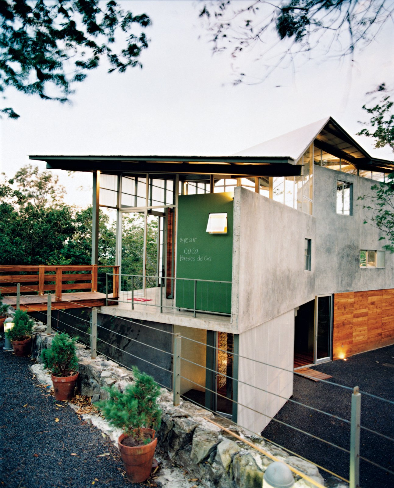 Exterior, Concrete Siding Material, and Wood Siding Material Banks of windows and translucent panels help keep Casa Tuscania nice and airy.  Photo 2 of 8 in Welcome to the Jungle