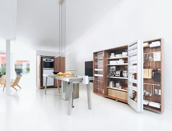 The Bulthaup b2 brings the woodshop into the kitchen with utilitarian workspaces and pristine, orderly wooden cabinet systems.  Photo 2 of 7 in An Introduction to Kitchen Design