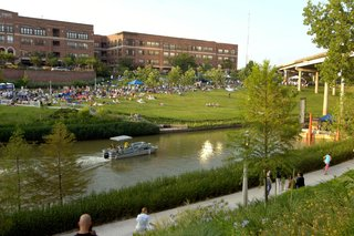 Houstonians enjoy the Blue Bayou Festival along the banks of the Buffalo Bayou. The city's annual calendar also includes the Bullunar hot-air balloon festival, the Bayou City Arts Festival, the Art Car Parade, the Livestock Show and Rodeo, the International Festival, and more. Image courtesy of the Greater Houston Convention and Visitors Bureau.