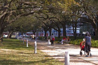 In addition to walking paths, Houston's downtown park Discovery Green offers an array of activities, from free yoga and Pilates classes to concerts and performances to a playground for kids and a man-made pond for steering electric boats. Visit Discovery Green online at discoverygreen.com. Image courtesy of the Greater Houston Convention and Visitors Bureau.