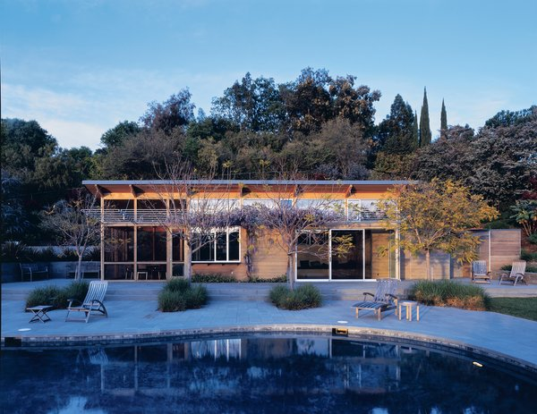 """A study in contrasts with the stolid stucco main house, this 750-square-foot pool house seems to float lackadaisically on the bluestone terrace. """"The pool house speaks of summer,"""" says designer E. B. Min.<br><br>Project: Burt Pool House<br><br>Architect: Min/Day<br><br>Location: Palo Alto, California"""