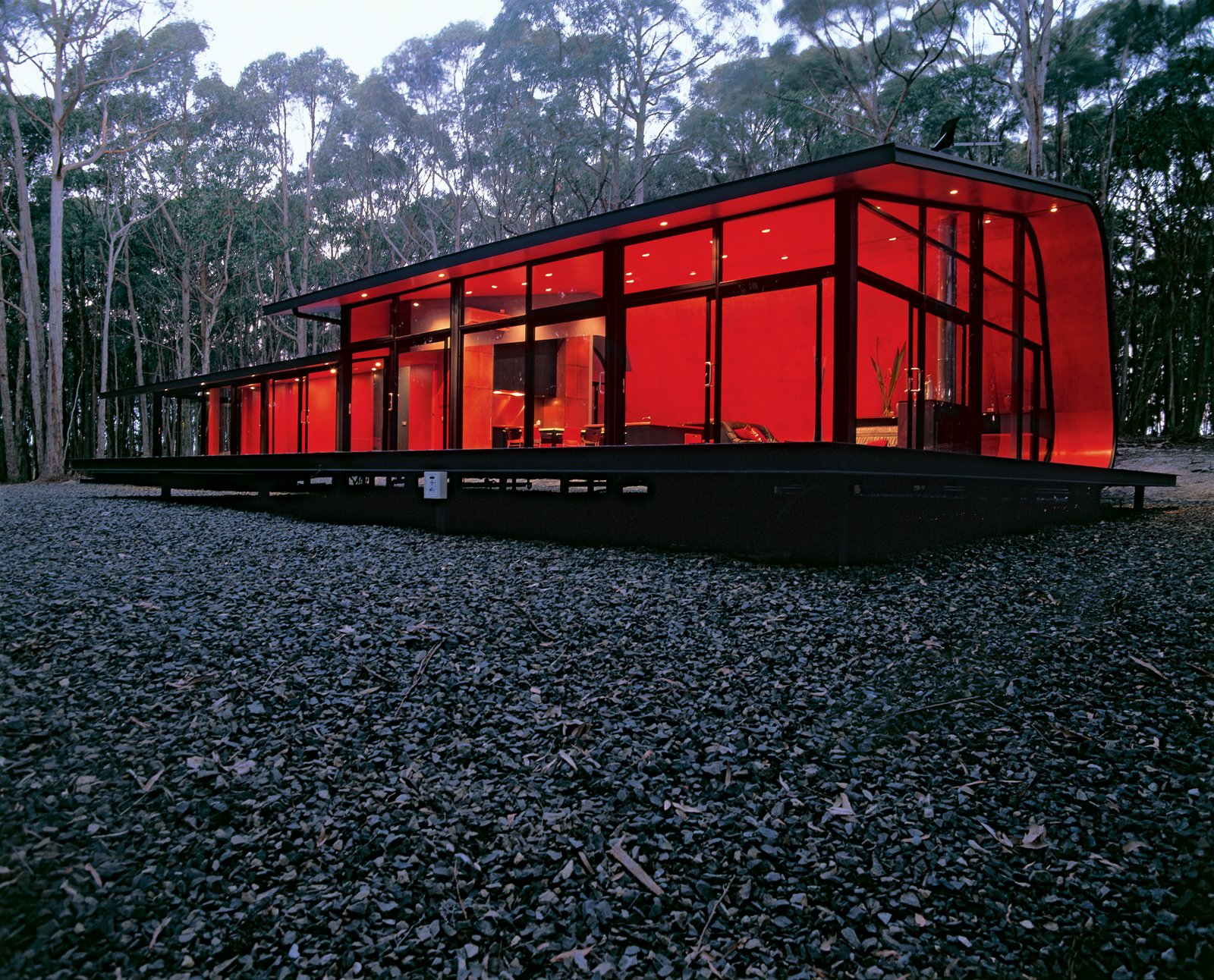 Exterior, House Building Type, Metal Roof Material, and Metal Siding Material With this curvy, glowing form, architect Jesse Judd has rendered the sometimes-harsh Australian bush habitable for his friends and family.  Photo 1 of 3 in Black, Red, and Green All Over