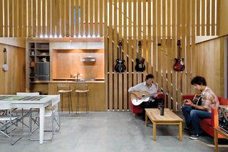 "20 Modern Living Rooms - Photo 6 of 20 - Guitarist Andrew McKenzie built his first home squat in the middle of a commercial apple orchard. Resembling a floating barn on the exterior, the interior is all modern, including McKenzie's choice of ""honest"" plywood walls over New Zealand's popularly-used GIB (a brand of plasterboard). A high ceiling - viewable as an asymmetrical apex from the outside - aids acoustics and makes the home feel larger than its modest 26x26 footprint. Read more about the McKenzie Residence here."